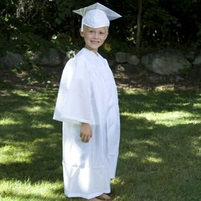 This is not one of my kids.  I'm pretty sure it is illegal to post pics of them on my blog without permission.  However, they were wearing white caps and gowns just like this kid.  (He is from an ad on Amazon.)